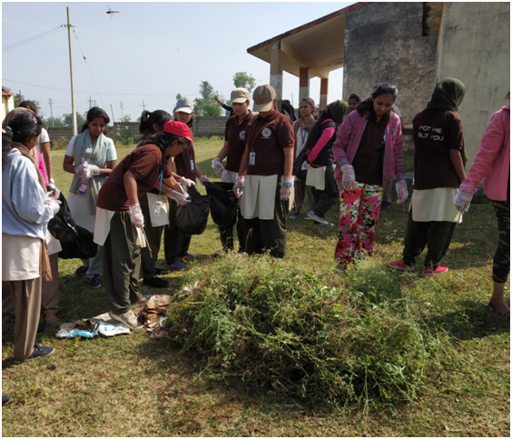 Students participating in cleaning village