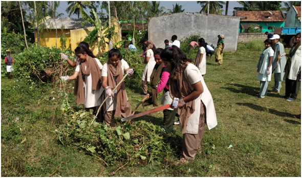 students involved in cleaning process of school
