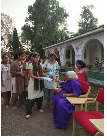 Distribution of Books and sweets to the volunteers