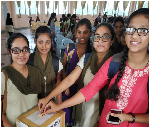 Photograph of students putting their contribution in collection box | GSSSIETW