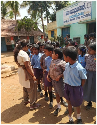 Photgraph of NSS volunteers creating cleanliness awareness to the School children